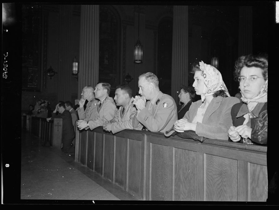 Noon Mass at St. Vincent de Paul's Church, New York City. Office of War Information Photographic Collection, Library of Congress. June 6, 1944.
